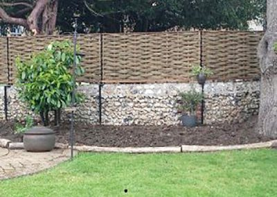 Willow Fencing Panels for Flint Garden Wall in Surrey