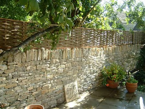 Woven Willow Panels on Drystone Wall