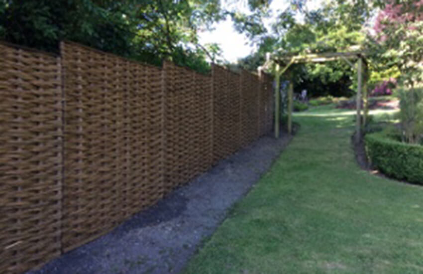 Garden defined by willow fencing